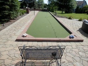 home putting green and bacce ball area