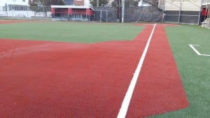 completed red artificial turf baseball diamond