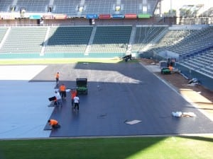 first rows of base panels are installed for artificial football field turf install
