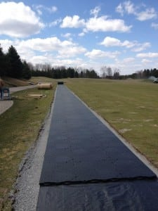 base system during artificial turf tee line installation