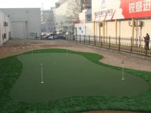 putting green installed on top of gravel area
