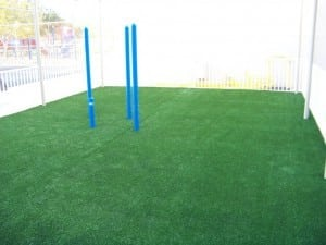 artificial grass laid before playground equipment installed