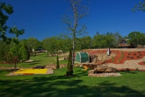 wide view of completed snag golf course with artificial turf and landscaping