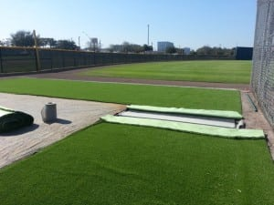 two artificial turf strips ready to be adhered together