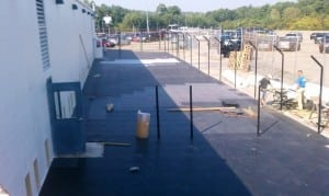 base panels laid out for artificial grass pet area